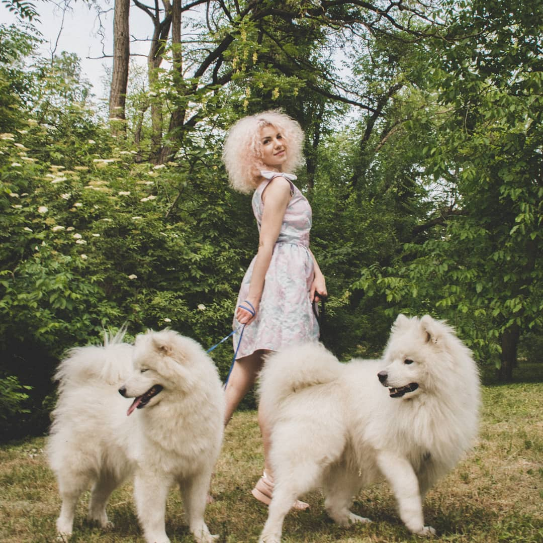 woman has matching hair with dogs