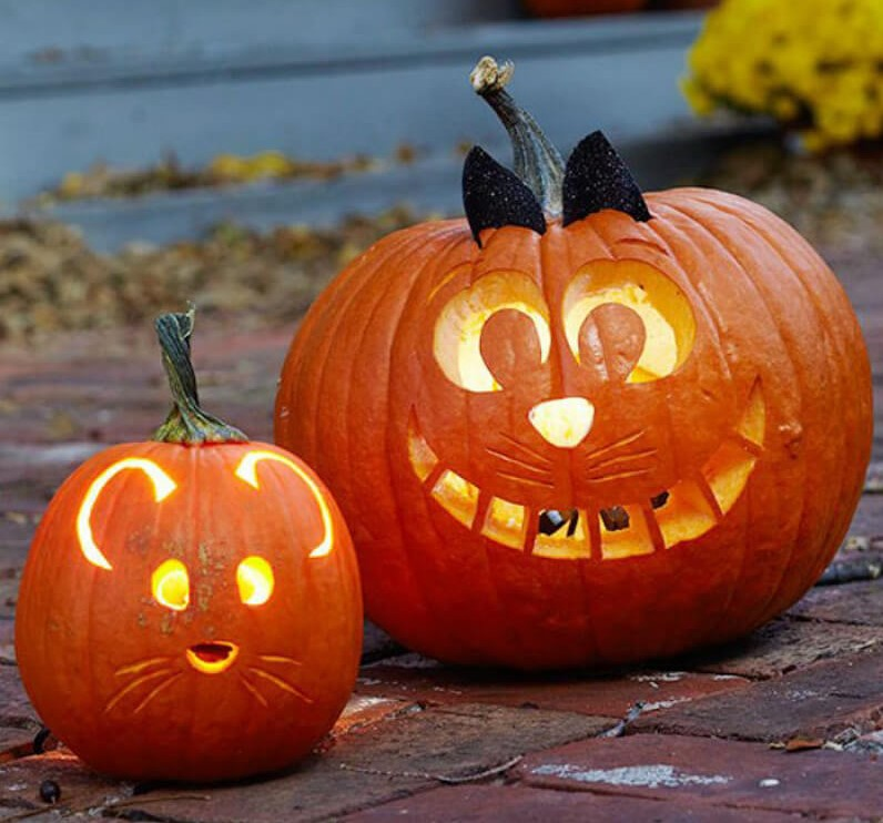 A small pumpkin is carved to look like a mouse next to a larger pumpkin made to look like a cat.