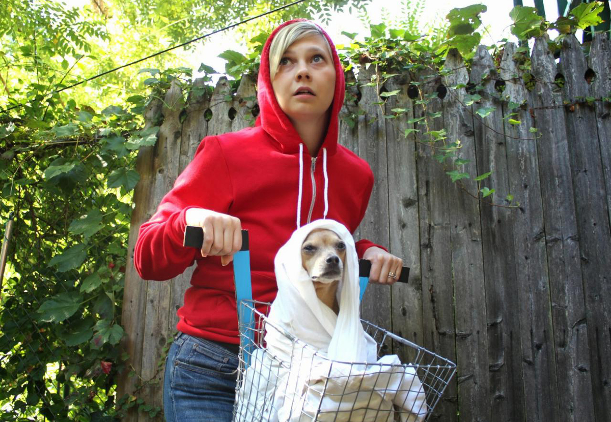 Owner dresses as Elliott and dog dresses as ET from the movie ET the Extra Terrestrial