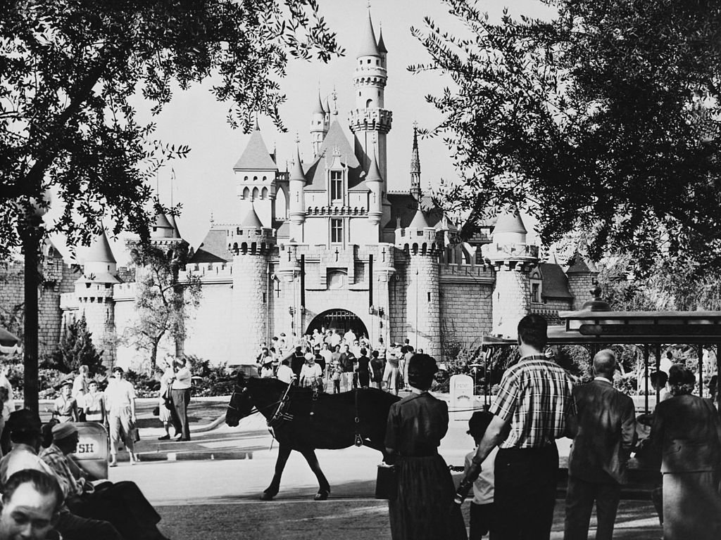 Patrons flood the entrance to Fantasyland.