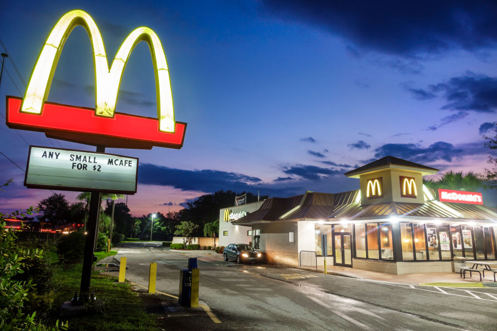 The sun sets over a McDonald's.