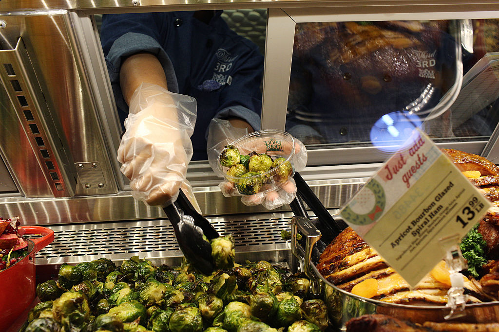brussel sprouts being selected at a store