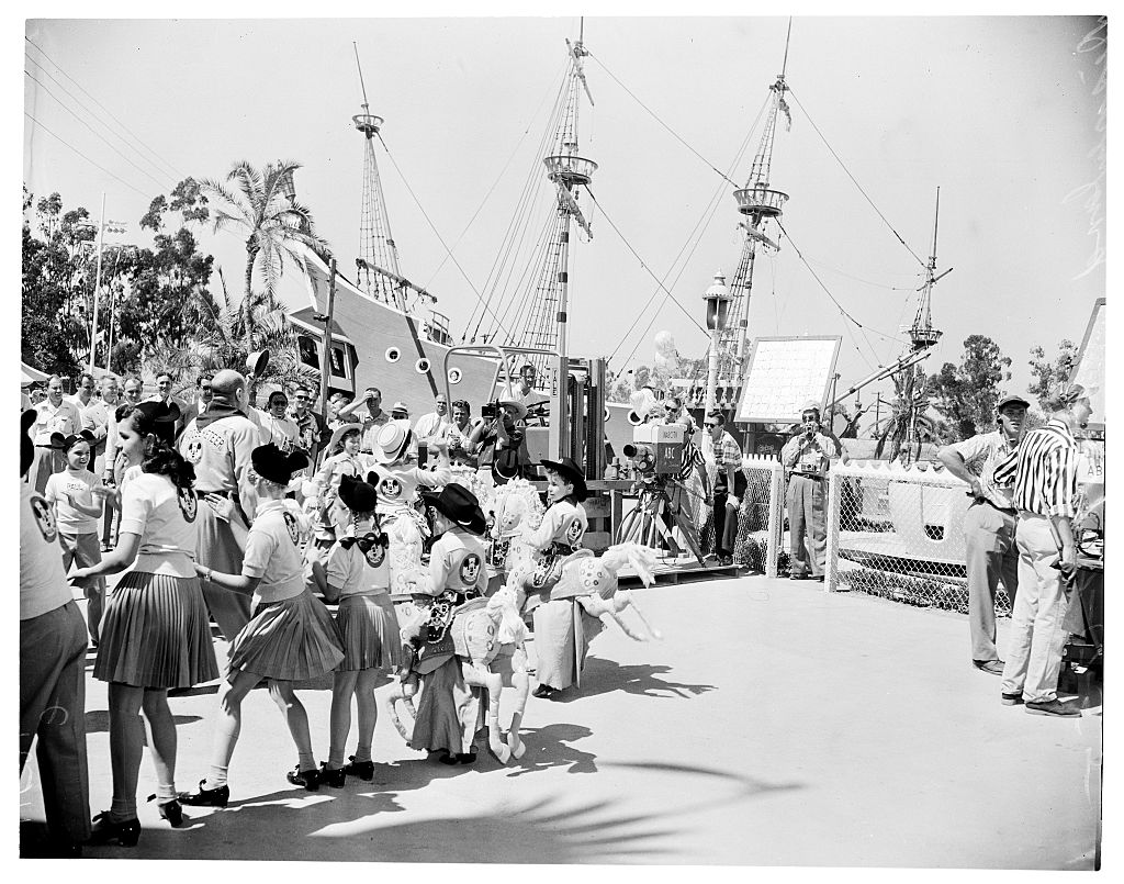 A pirate ship is crowded with children at Disneyland.