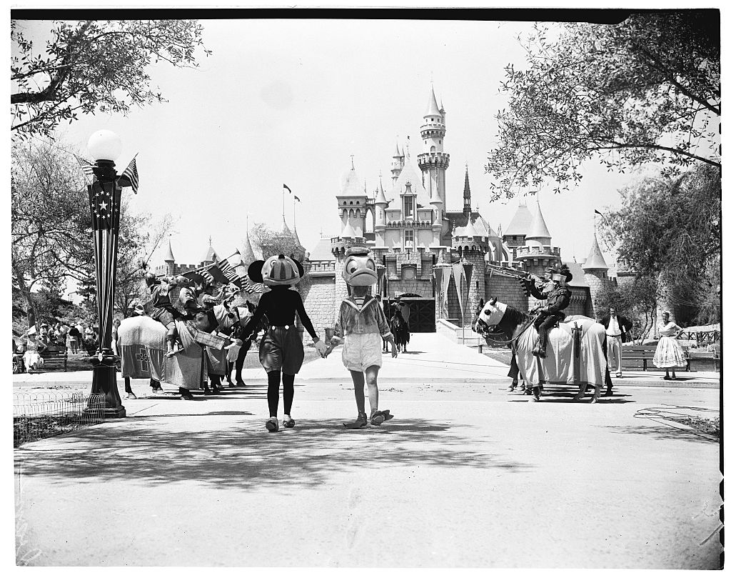 Mickey Mouse and Donald Duck walk together in front of Fantasyland.