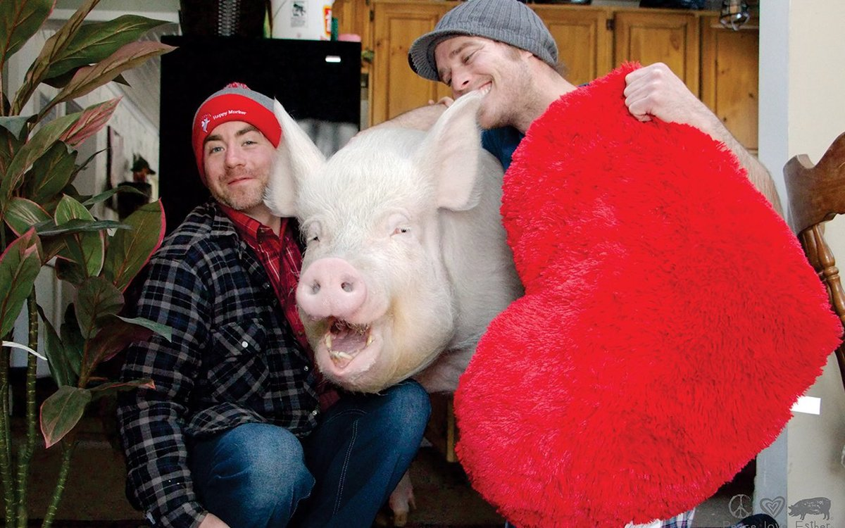 Steve and Derek hold a giant plush heart near Esther.