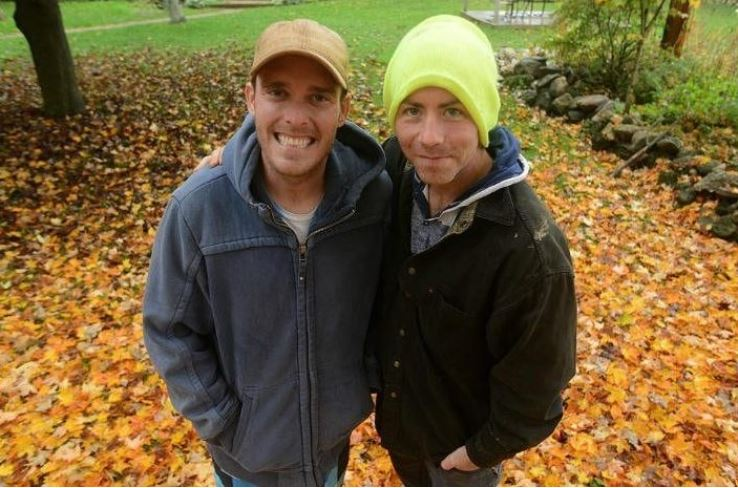 Steve and Derek take a picture in autumn.