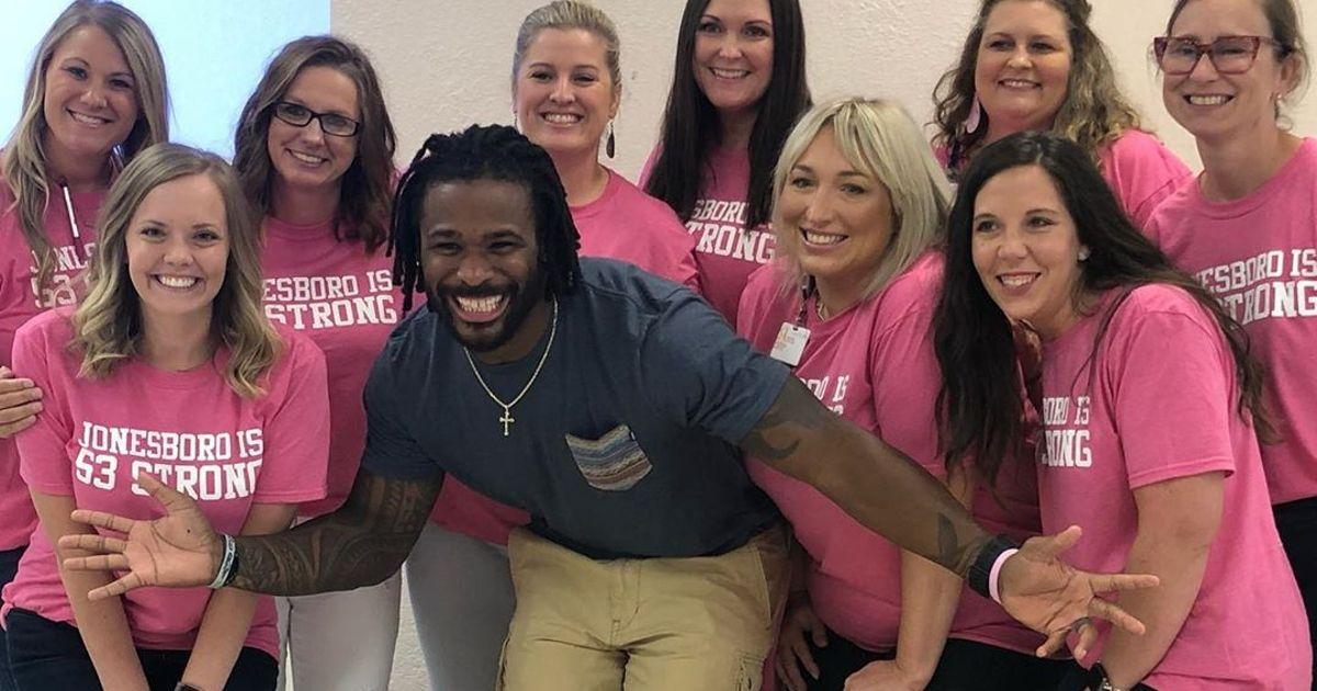 Williams with women in pink shirts at a 53 for Sandra event