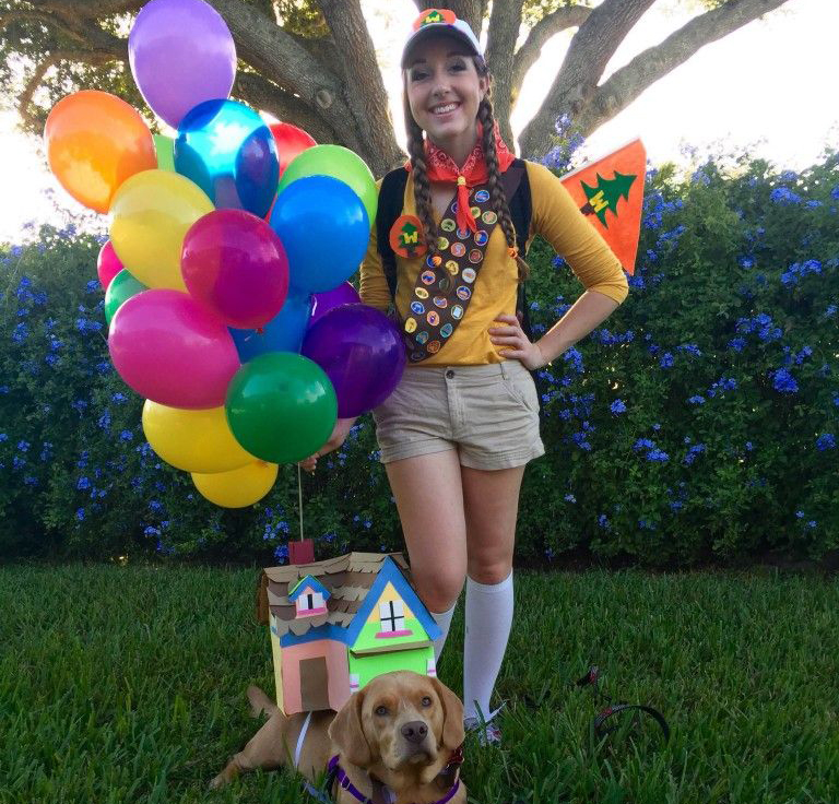 Owner dresses as Russell with dog as the house from the Pixar movie Up