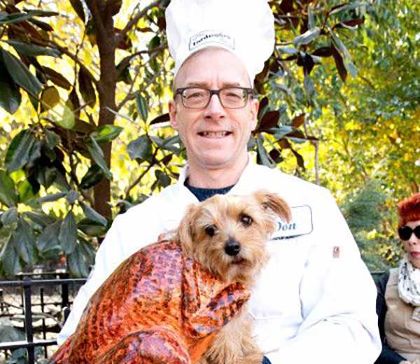 Dog owner dressed a chef with dog dressed as a turkey