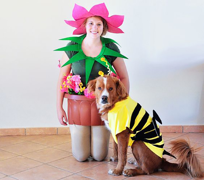 Owner dresses as a flower and the dog wears a bee costume