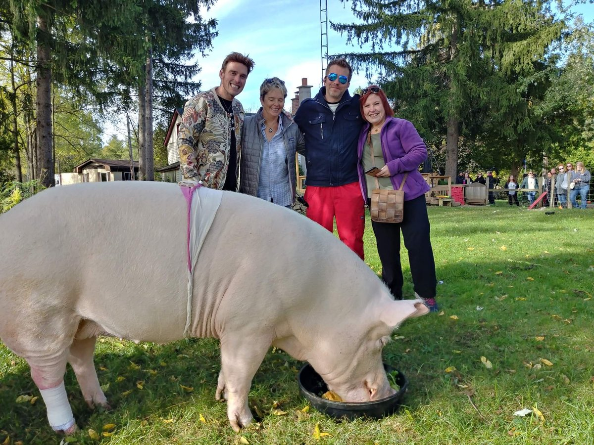 Derek and Steve take a picture with two raffle winners and Esther on their sanctuary.