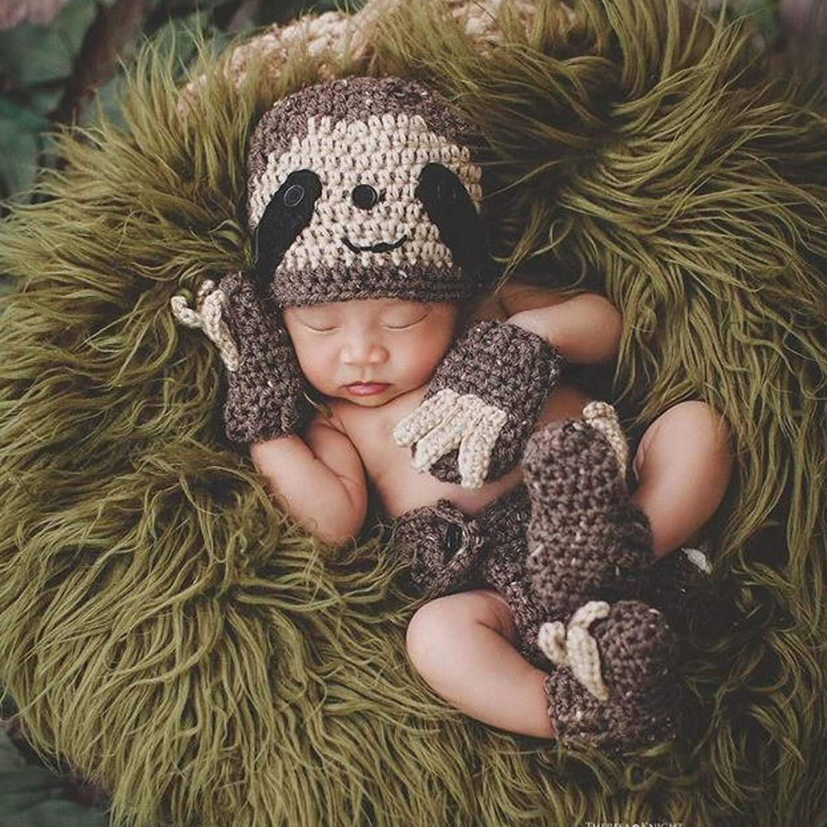 baby dressed as a sloth