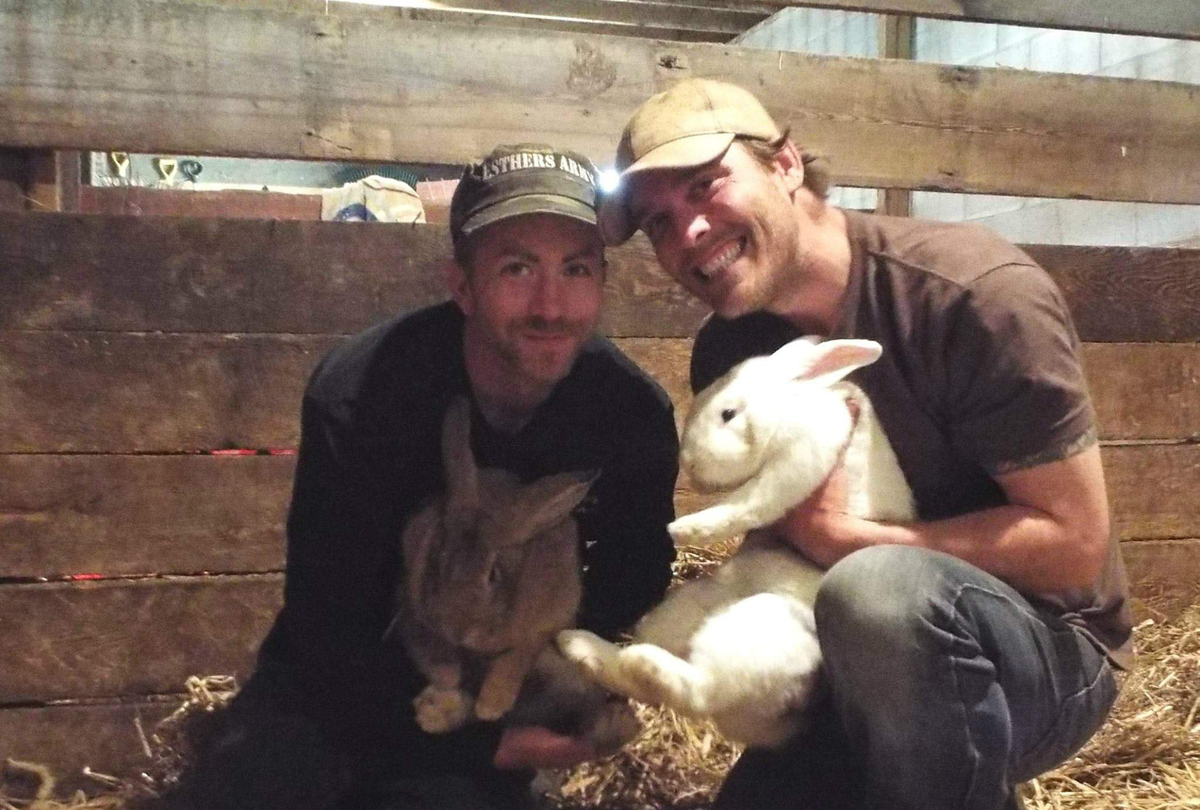 Derek and Steve hold two bunnies, Terry and Benedict.