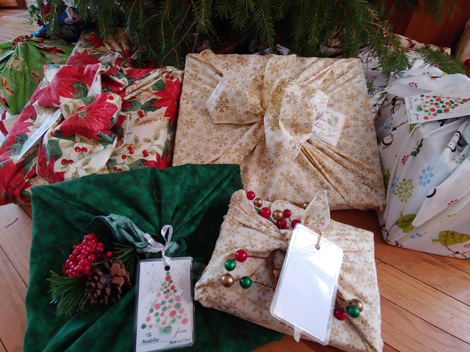 fabric gift wrap under a christmas tree