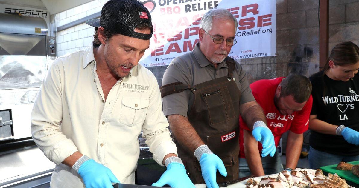 Matthew McConaughey and Wild Turkey Master Distiller Eddie Russell prepare food during Wild Turkey
