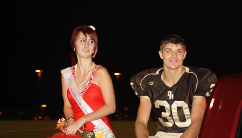 Whitney wears a weak smile while dressed as Homecoming Queen.