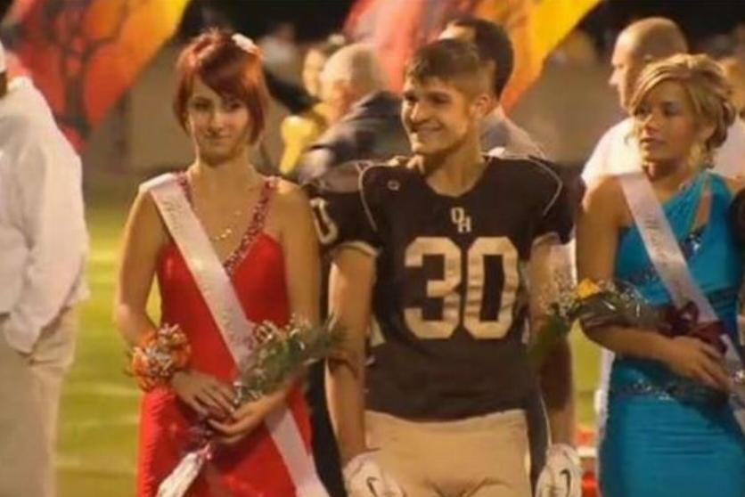 Whitney looks distraught while walking beside the homecoming king.