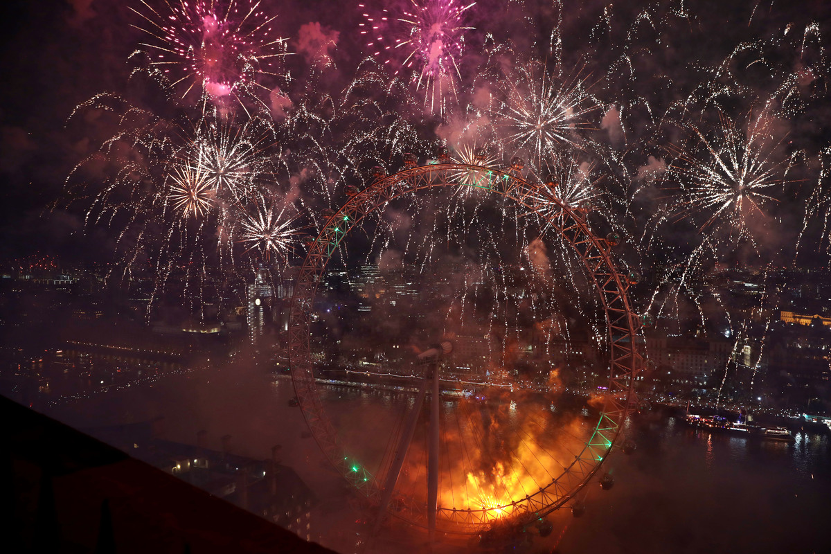 Fireworks explode over The London Eye.