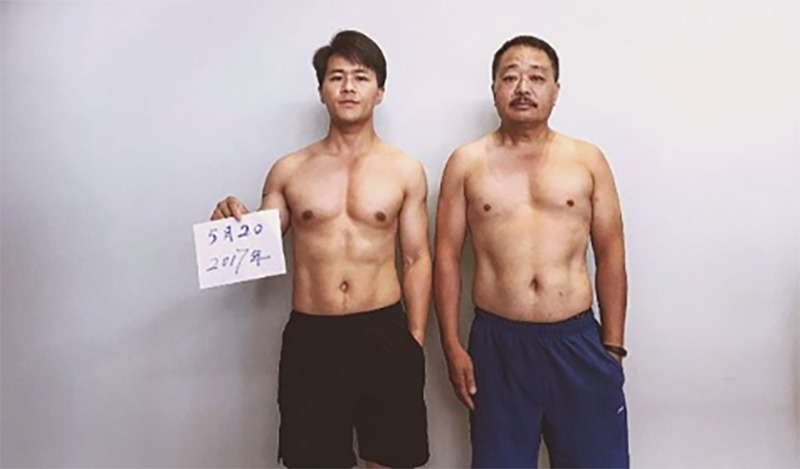 Jesse and his father take a photo two months into their fitness journey.