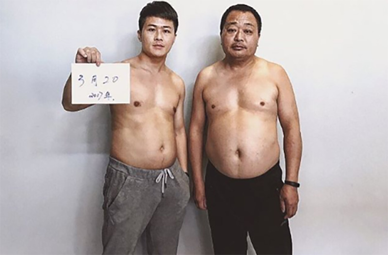 Jesse and his father take a photo at the beginning of their fitness journey.