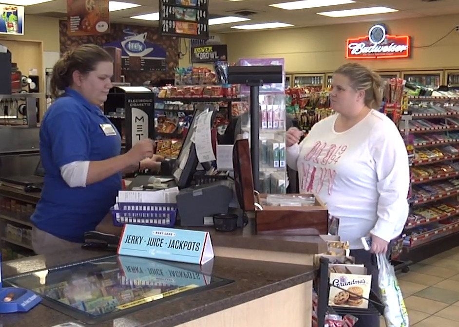A customer purchases items at a Trex Mart in Missouri.