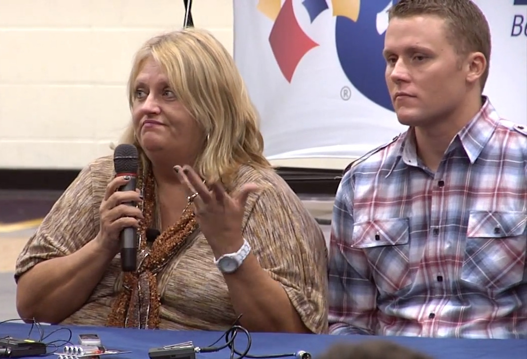 Cindy Hill sits next to her son during an interview.