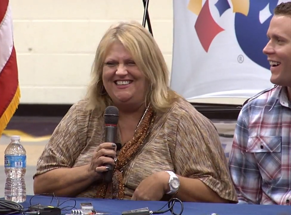 Cindy Hill and her son laugh during an interview.