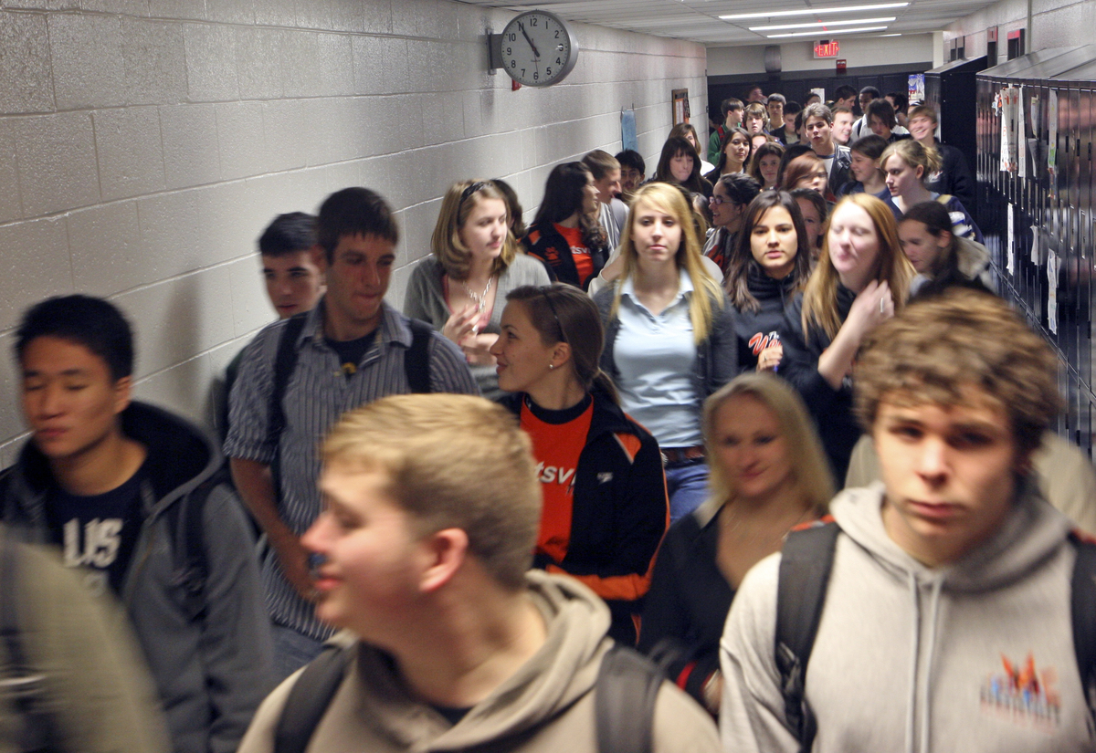 Students walk down the halls of the high school.