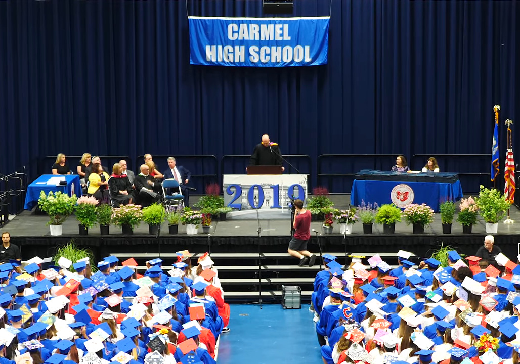 The crowd watches Principal Riolo at the podium of the Carmel High School graduation ceremony.