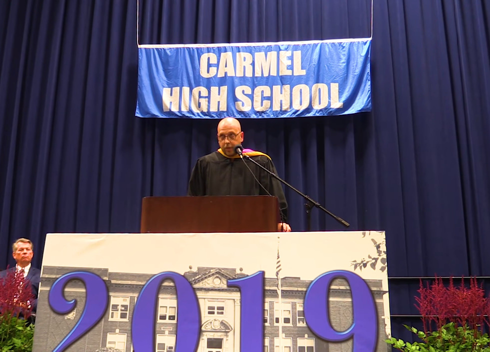 Principal Riolo gives a speech about Jack Higgins during the Carmel High School graduation.