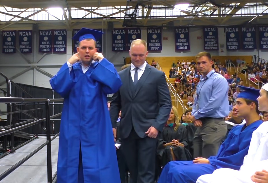 Jack Higgins plugs his ears at his graduation ceremony.