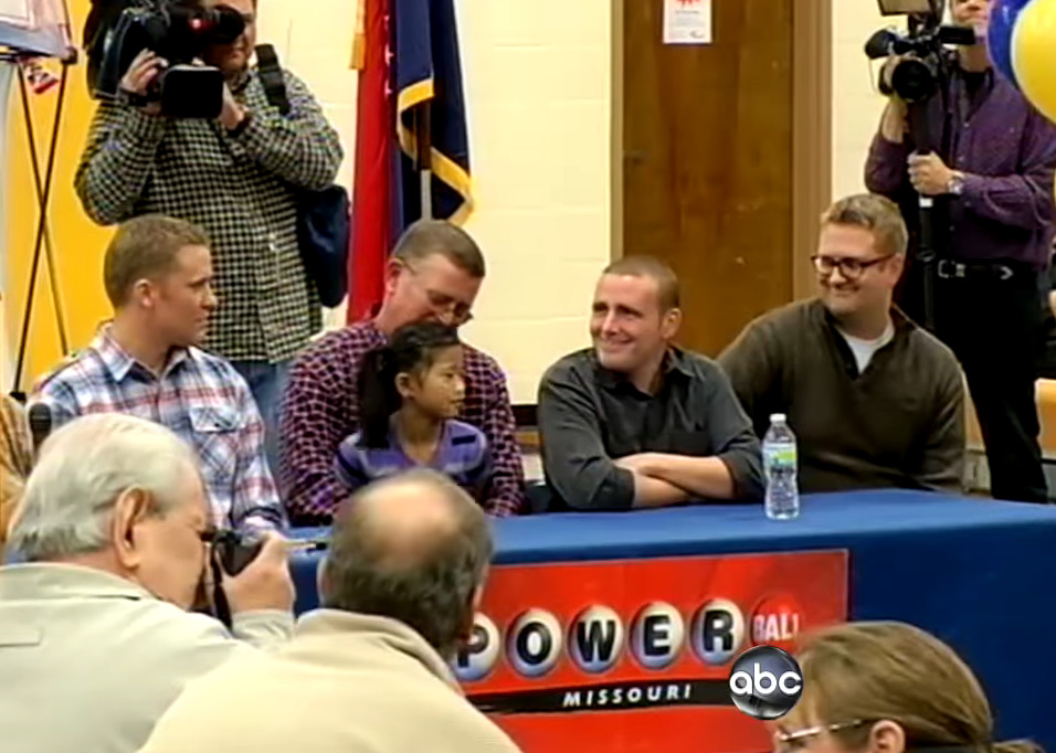 Mark Hill sits with his three sons and daughter during an interview.