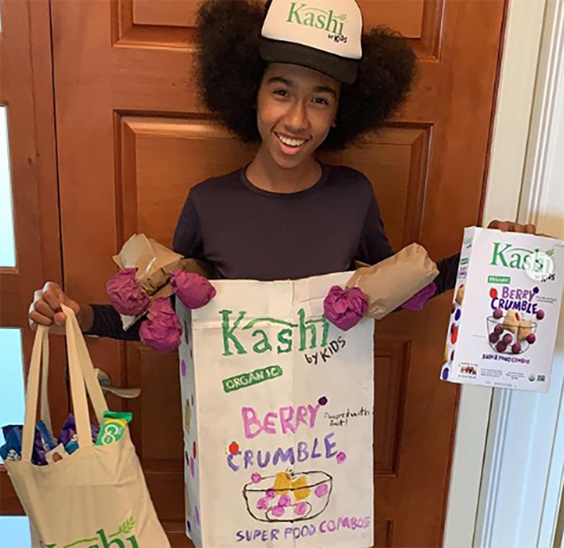 Tabay dresses in a homemade Kashi cereal box for Halloween.