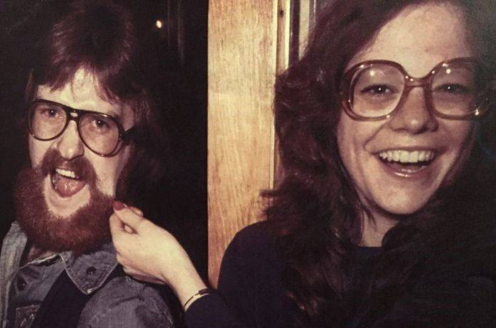 Janet jokingly pulls on Adrian's beard back in the '70s.