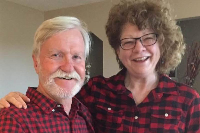 Janet and Adrian pose together wearing matching plaid.