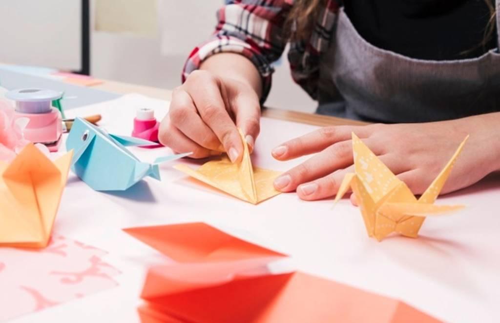 Person folding origami