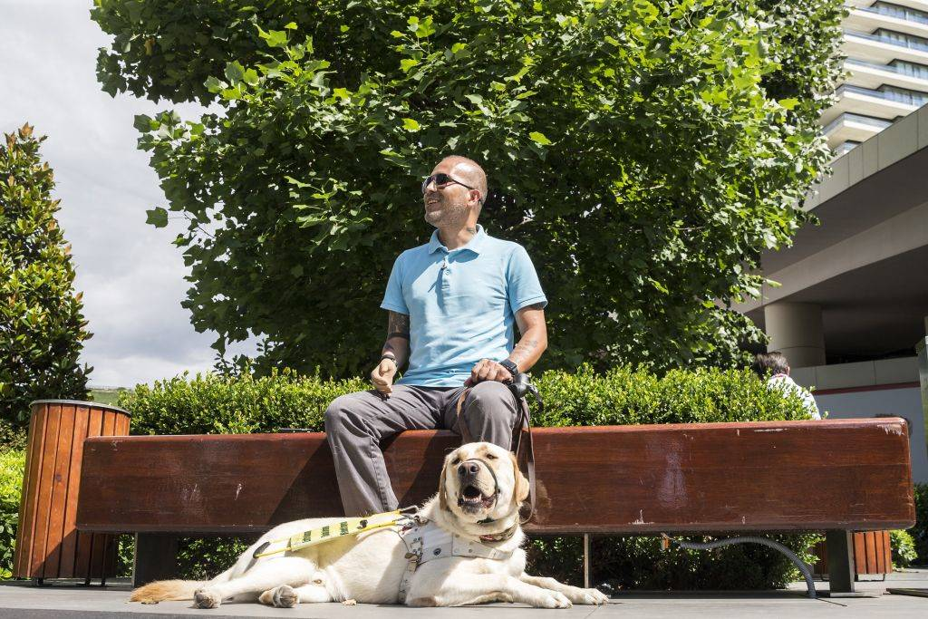 a man sits with his dog