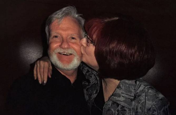 A recent photo shows Janet kissing Adrian on the cheek.