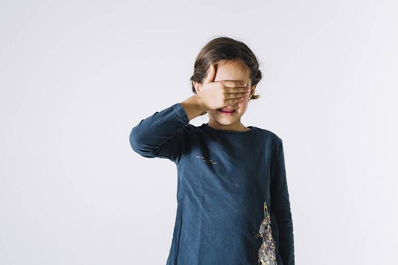 Kid covering their eyes