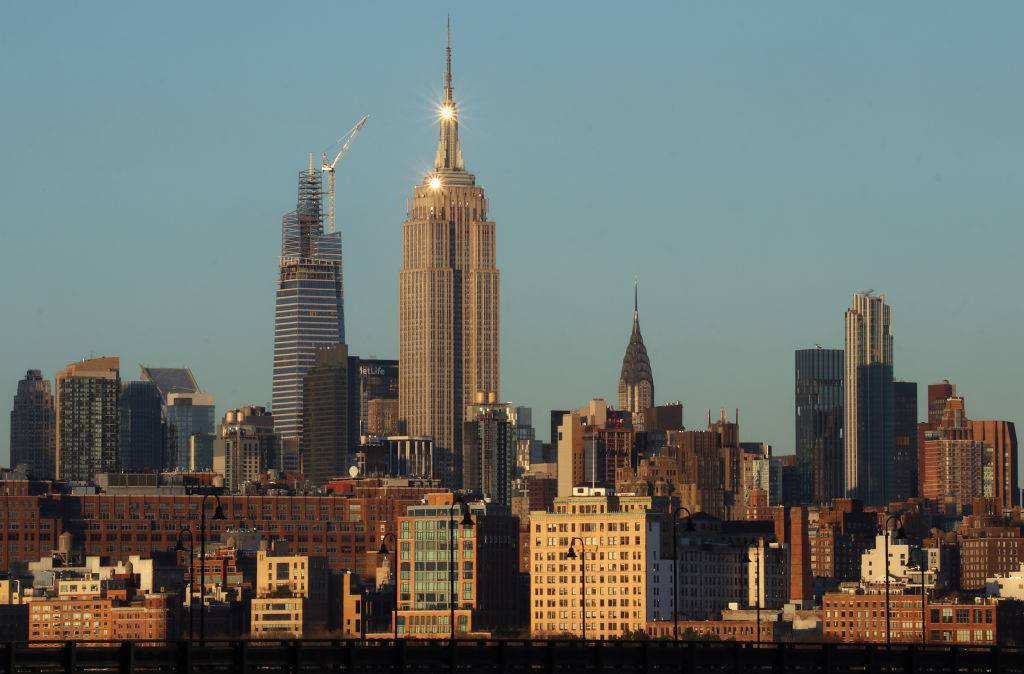 a view of the new york skyline featuring the empire state building in the middle