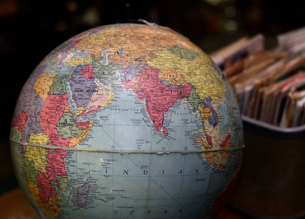 an old globe of the world pointed toward india