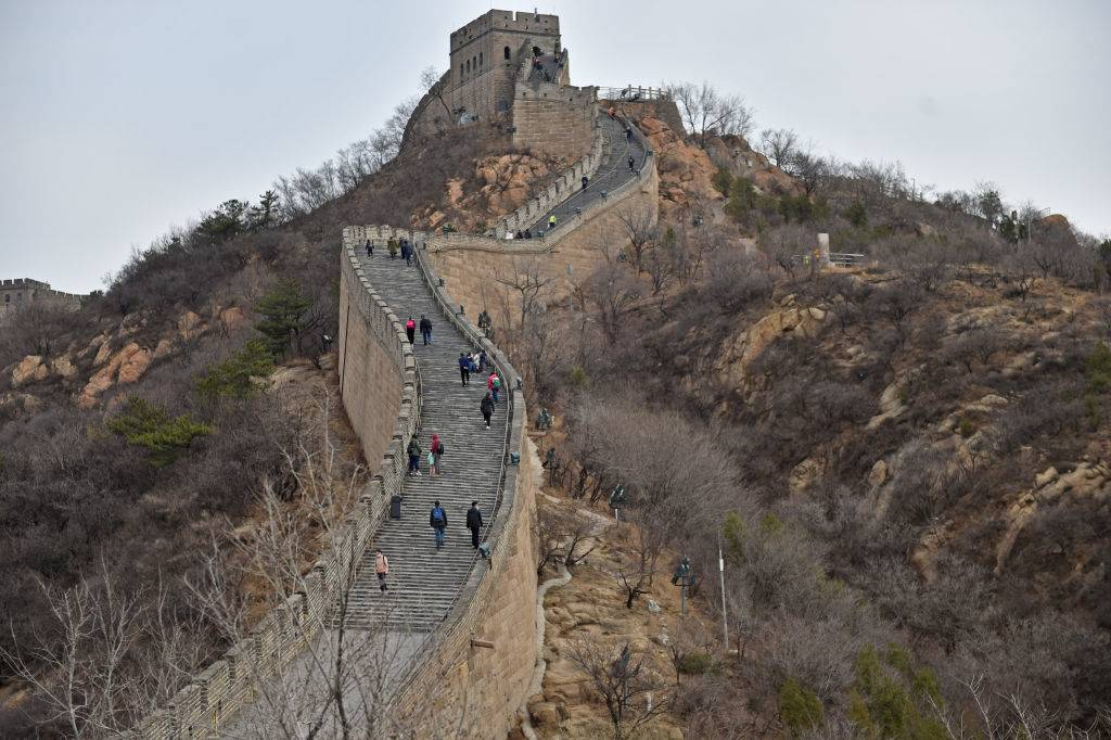 an aerial view of people walking up the great wall of china