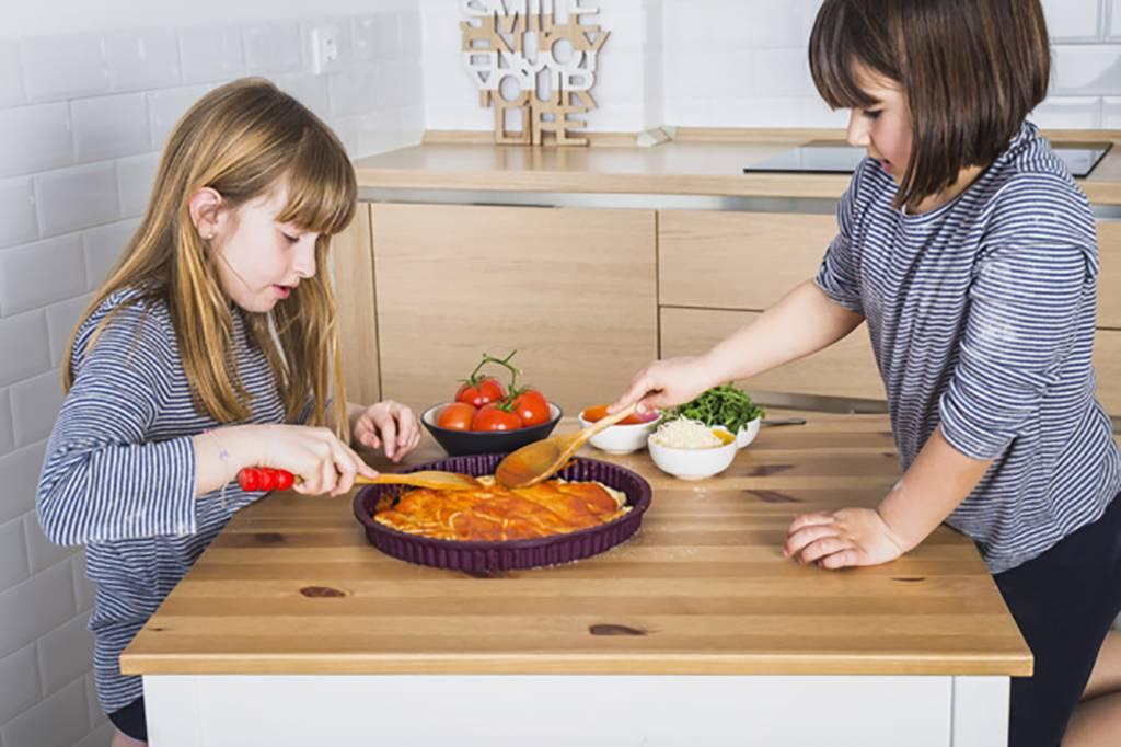 Girls making a pizza