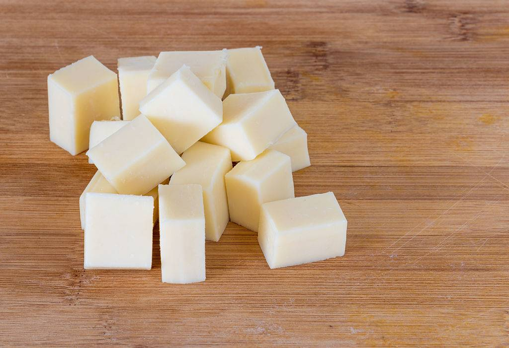 white cheese cubes on a wood table