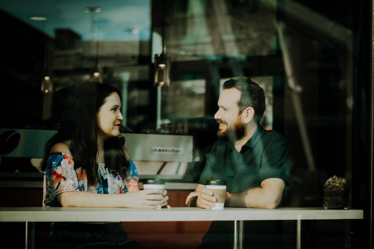 couple in coffee shop talking