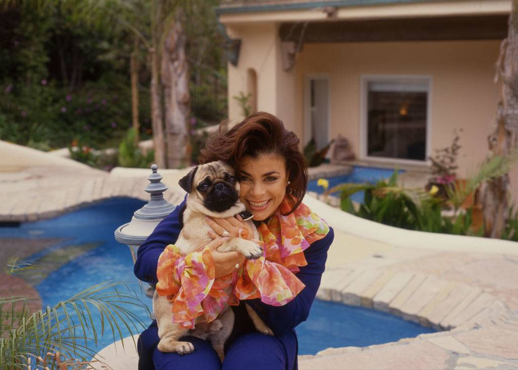 Paula Abdul poses with her pug in 1990.