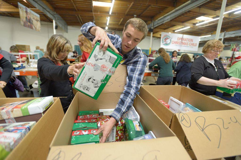 shoeboxes full of donated goods at a warehouse