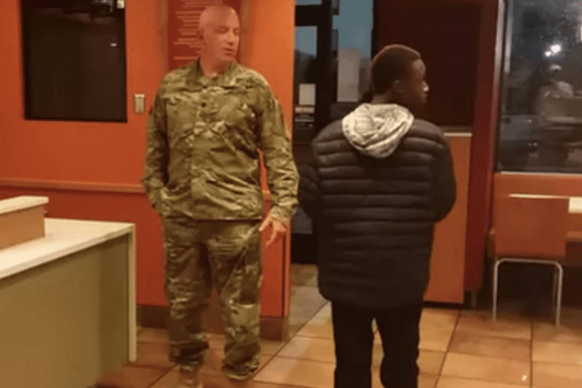 A soldier buys a boy Taco Bell.