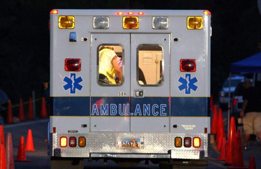 An ambulance is photographed from behind.