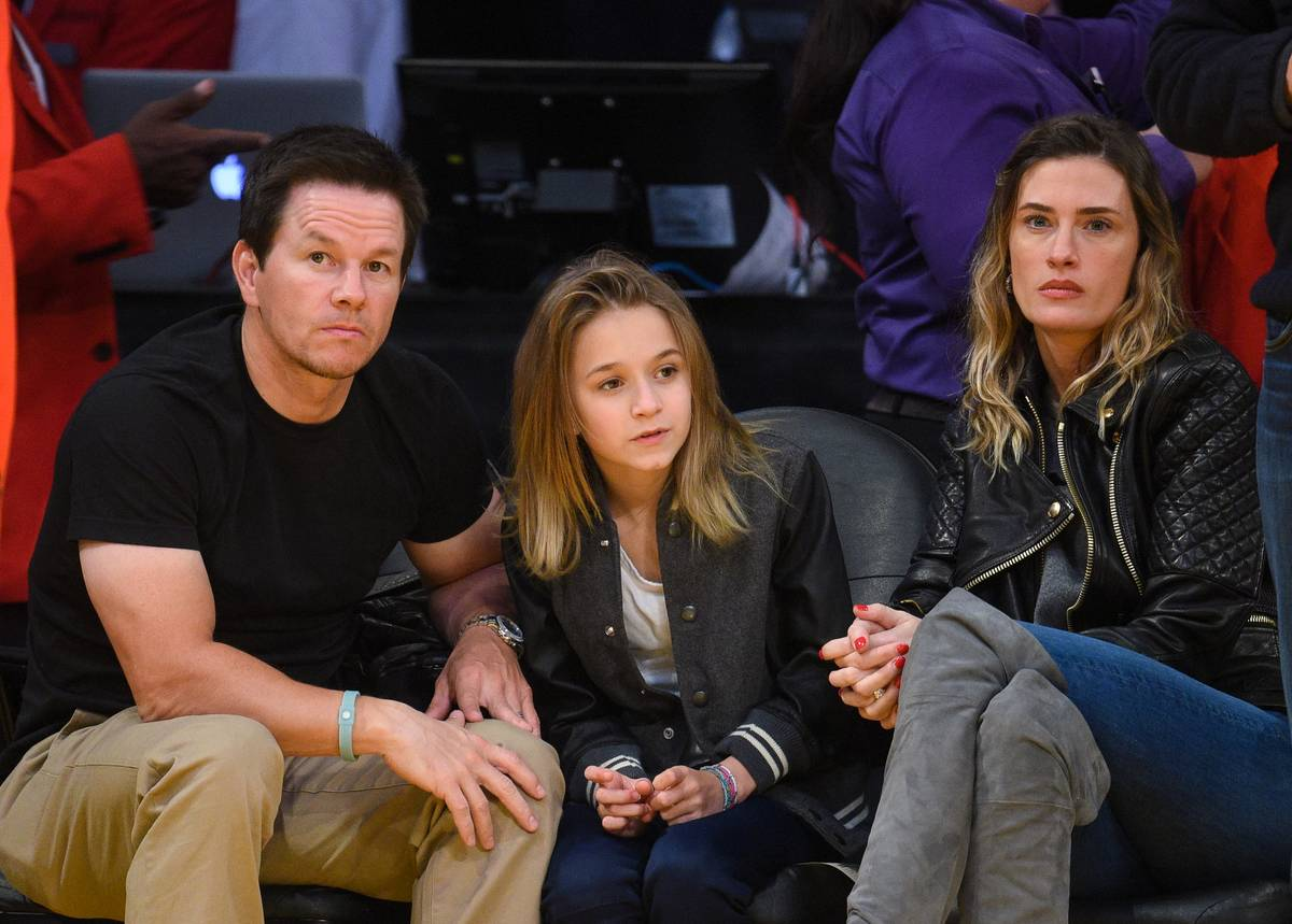 Mark Wahlberg And His Wife Sandwiching Their Daughter On The Kiss Cam